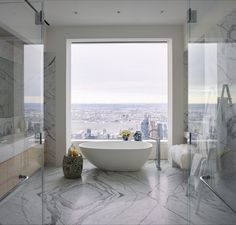 Artsy Living Gallery by Kelly Behun A sculptural freestanding bathtub is positioned in front of a window, so visitors can imagine themselves enjoying the view while taking a soak.