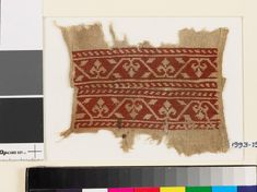 Textile fragment from a belt or scarf with trefoils and leavesfront