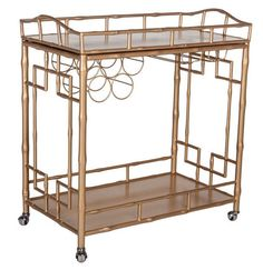 Fun on Wheels: The Sedgewick faux-bamboo bar cart is a merry mixer with a removable tray and wine rack; $515.