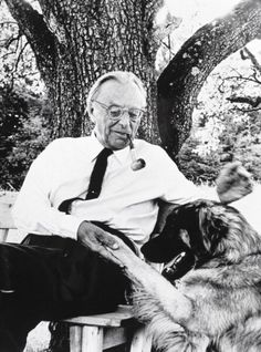 Carl Orff shakes hands with his dog.