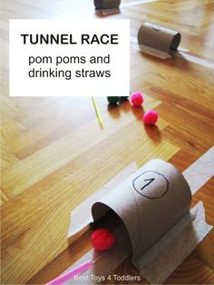 Simple tunnel race game with pom poms and drinking straws. Kids had fun trying to blow pom poms through the tunnels and keeping them on the path.