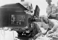 """William Wyler shooting """" Ben-Hur"""". I love how this photo shows the Panavision 65 camera capturing the shot."""
