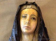 virgen antigua de madera,Cap i Pota, manto de cartón piedra y ojos de cristal. Siglo XVIII.