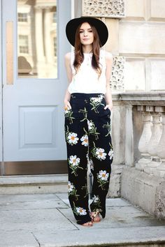 These wide-leg floral pants look absolutely perfect with a basic white cotton top and a hat.