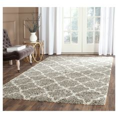 Traditional medallion tile designs are treated to the comforting look and feel of a plush shag pile in this elegant floor covering from the Hudson Collection by Safavieh. A classy color palette adds a brilliant look to the all-over medallion pattern that is set into the lush pile of this luxurious shag. Soft underfoot and pleasing to all senses for an easy-care, durable carpet perfectly styled for metro-mod décor or to add a stylish finish to classy country home furnishings.
