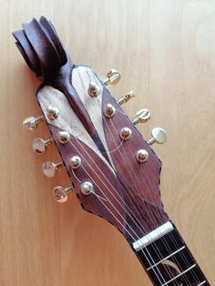 handmade by Erik Houtman, curved front (spruce) and back (walnut), sides (walnut), scale length 350 mm. Neck (sapele), fingerboard (ebony). Inlay: birch, cherry and rosewood. Mandolin, Musical Instruments, Birch, Cherry, Scale, Building, Handmade, Design, Guitars