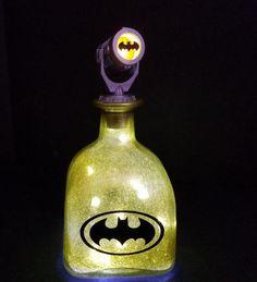 Batman Bat Signal led bottle light Batman by BottlesForFunShop Led Bottle Light, Bottle Lamps, Wine Bottle Art, Bottle Lights, Comic Book Crafts, Batman Light, Bat Signal, Perfume Bottles, Display