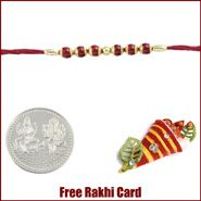 Red Beads Rakhi to Canada with Free Silver Coin