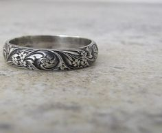 Maybe a bit like the rose ring worn by Rhodry? I'm thinking a thicker, flatter band than this, though.