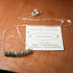 Easily dressed up or down, you can get a lot of wear out of this simple, sparkly, eye-catching necklace. Faceted rondelles of genuine gemstones are stacked at the base of a delicate sterling silver chain. The clasp is flanked by two more gemstone beads. - Labradorite gemstone, 4mm -