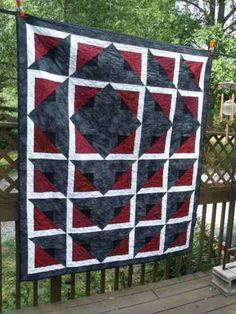 """don't know the quiter, pattern is """"Radiant"""" by Daniela Stout, published by Cozy Quilt Designs. Instruction video here: https://m.youtube.com/watch?v=6xJ1ziuU-c4"""