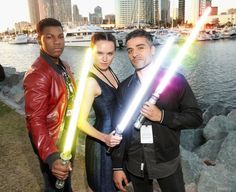 John Boyega, Daisy Ridley and Oscar Isaac with their preferred lightsaber crystals. Gold, silver and rainbow. [x]