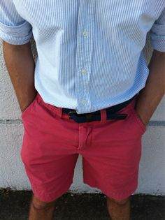 Bold shorts with a classic shirt and belt - finish with boat shoes or driving shoes