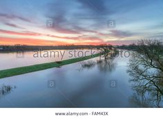 Clifton Ings, York, UK. 01st Jan, 2016. View over river Ouse and distant York Minster at dawn on New Year's Day 2016. © John Potter/Alamy Live News
