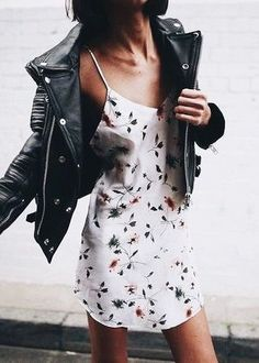 Black leather jacket over cute print dress.