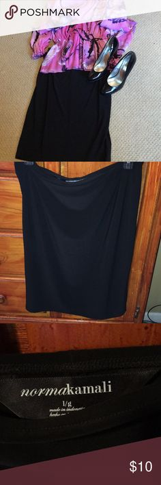 """Norma Kamali Black KNEE length skirt Norma Kamali Black Skirt. I'm 5'11"""" and it reached to my knee. I realized I had 3 of these! Take one off my hands. Comfy and soft and an essential for your closet. We must all have a little black skirt and a little black dress so here is your skirt. Pair with heels, booties, Vera Wang or MK sandals Norma Kamali Skirts Midi"""