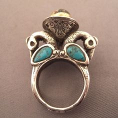 """Silver, gilded, turquoises, pearl of Venice, Iran     Description     A very original ring from Iran with two bird heads, 4 turquoises and an ancient pearl of Venice and a very refined work on the body of the ring ...      Size:7,5 adaptable    Weight:25,90gr  www.halter-ethnic.com  see """"My Lucky Finds"""""""
