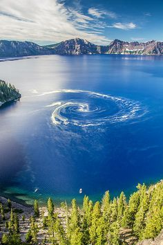 Giant swirl phenomenon at Crater Lake National Park, Oregon. A giant swirl of pollen formed on the surface of crater lake.