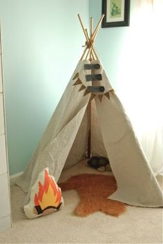 The DIY teepee (get Michelle's instructions on how to make your own here) comes complete with a faux fox fur rug and a campfire pillow, both of which Michelle also made.
