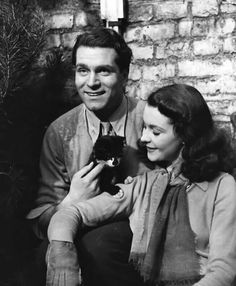 Laurance Olivia and Vivien Leigh and there cat Lissy they adopted in 1941