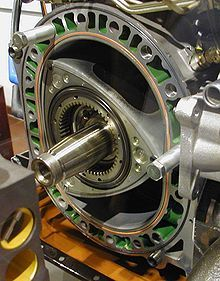 The Wankel engine is a type of Internal Combustion engine using an eccentric rotary design to convert pressure into a rotating motion instead of using reciprocating #pistons. Its four-stroke cycle takes place in a space between the inside of an oval-like epitrochoid-shaped housing and a rotor that is similar in shape to a Reuleaux triangle but with sides that are somewhat flatter.