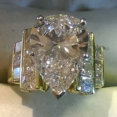 The Chic Technique: Pear-shaped diamond engagement wedding ring with four rows . The Chic Technique: Pear-shaped diamond engagement wedding ring with four rows of diamonds. Diamond Wedding Rings, Diamond Engagement Rings, Diamond Rings, Bridal Rings, Wedding Bands, Diamond Jewelry, Jewelry Rings, Fine Jewelry, Gold Jewellery