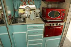 vintage travel trailer - turquoise and red kitchen - I have the microwave.all I need is the camper!