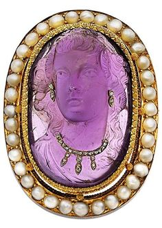Victorian Amethyst Cameo, Half-Pearl, Diamond, Gold Brooch. Featuring an oval-shaped amethyst cameo measuring 36.00 x 24.24 x 13.41 mm, accented by rose-cut diamonds, surrounded by half-pearls set in 18k gold. #Victorian #cameo #antique #brooch