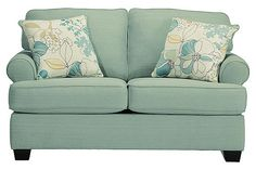"""The Daystar - Seafoam Loveseat from Ashley Furniture HomeStore (AFHS.com). The """"Daystar-Seafoam"""" upholstery collection features stylishly shaped set-back arms along with the supportive seat and back cushion beautifully adorned with welt detailing to create an inviting contemporary styled collection that offers a refreshing look and the comfort perfect to enhance any living area."""