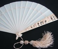 Exquisite Ivory 19th C. Brise fan.  The ivory sticks are held together with satin ribbon, and finished with a gorgeous silk tassel.  Note the beautifully carved guardsticks.