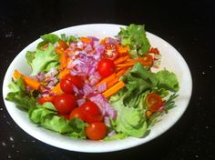Salad fresh, coral lettuce, cherry tomato, sliced carrot and diced red onion!