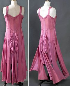 Evening dress, American, ca. 1928-30. Very fitted, requiring opening on left side that closes with hooks & eyes. Ten long narrow panels of same silk crepe attached from neck to hipline, where panels quickly expand as they hang loose from dress. When wearer stood still, panels lay smooth & soft around her legs, but when she danced, they swing. Smith College Historic Clothing.