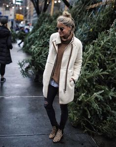 Winter outfits are all about the #layers! Mix up textures and tones, like the leopard print boots and #shearling coat here.