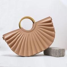 Vegan handbags. Vegan Bags. Vegan Leather. Cruelty Free. Pinatex. Handbags. Plant based. Cactus Leather. Grape Leather. Apple Leather. Pineapple Leather (Pinatex). Recycled. Recycled materials. Cork. Vegan Fiber. Peta Approved. Designed in NYC. Best handbag Brand Award recipient in Milan, Italy. Vegan.