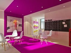 Bold office lounge room in bright purple according to their corporate colours.  Office interior design by Traart Private Limited.  #interiordesign #traartinteriordesign #officeinteriordesign
