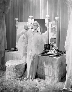 Create a space of your very own to pamper yourself and get ready in your home. A beautiful dressing table brings back that old Hollywood glamor and is the foundation of a Seductive Boudoir™- (Jean Harlow's fully fringed boudoir)
