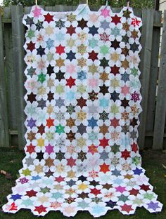 quilt star | have more stars made and I'm slowly working at getting another row ...
