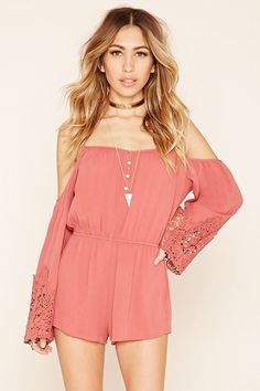 Crafted from crinkled woven gauze, this open-shoulder romper features a four-button placket at the neckline, adjustable cami straps, an elasticized waist, on-seam side pockets, and long bell sleeves with ornate crochet cuffs.