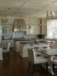 Flat boards rather than traditional moldings create a coffered effect that works well with a transitional kitchen.