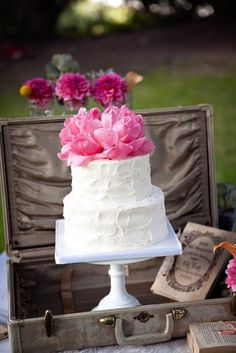 Rustic frosted cake with flower topper