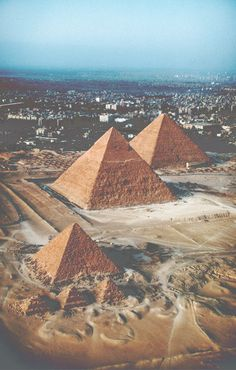 The Pyramids from the air  -  Cairo Egypt  -  Giza plateau  -  among the 7 wonders of the world  -  the 3 pyramids & the sphinx are believed to have been built some 5,000 years ago during the 4th dynasty of Egypt's Old Kingdom  -  how the ancient Egyptians managed this almost miraculous feat of architectural engineering is another question.