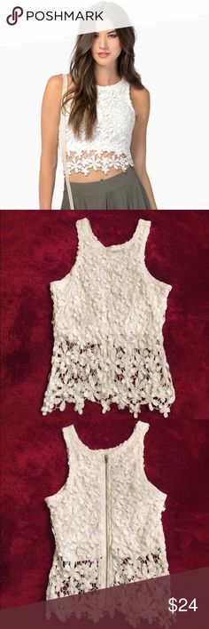 """Tobi White Lace Sleeveless Crop Top Flowery white crop top! Perfect condition. Great for music festivals/concerts☀️ The fabric is pristine white! No stains. Size medium but it runs small. Feel free to ask for measurements! """"Have a Daisy Day""""   Self is 100% cotton and lining is 100% polyester Back zipper closure White Only worn once Tobi Tops Crop Tops"""