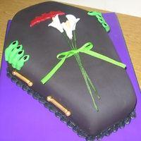 Chocolate cake with choc. mousse filling.  Fondant decorations, gumpaste flowers