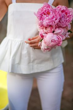 White outfit with pink peonies.