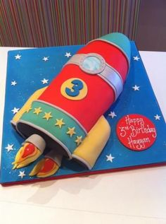 Based in Urmston, Manchester, Richards Cakes create stunning cakes for all occasions. We also sell online tutorials and cakes classes. Rocket Ship Cakes, Rocket Cake, Dragon Ball Z Shirt, Dbz, Birthday Ideas, Shirts, Cake Ideas, Cool Ideas, Fiestas