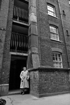 993. Mrs Emma Green in the entrance to a block in Great Eastern Buildings Quaker Street
