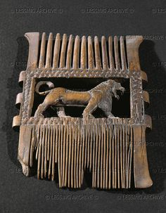 EGYPT IVORY 5TH BCE     Comb decorated with a lion. From Israel. Ivory, 27th Dynasty, Late Period     Louvre, Departement des Antiquites Egyptiennes, Paris, France