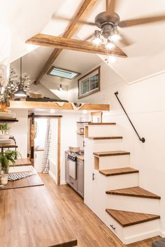 With plenty of custom features, this home became a home for a old traveler who uses it as a home base when she's not on the road. Tiny Loft, Tiny House Loft, Modern Tiny House, Tiny House Living, Tiny House Plans, Tiny House On Wheels, Tiny House Design, Inside Tiny Houses, Tiny House Storage