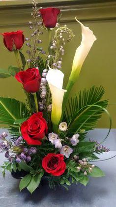 Calla lilies, roses, delphinium