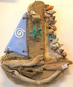 Small Driftwood Yacht with Blue Ceramic Sail by Karen Watson we sell Karens great driftwood pieces in Everything Westward